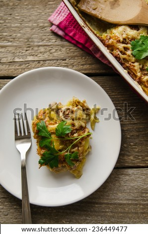 baked potato with meat and cheese on white plate - stock photo