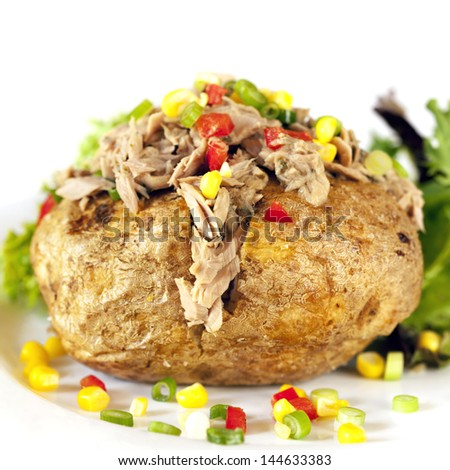 Baked potato with tuna and vegetables. - stock photo