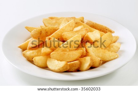 Baked potatoes wedges - stock photo