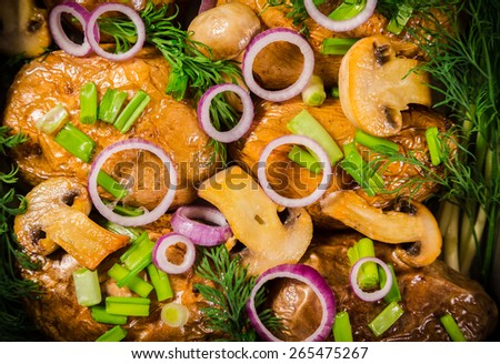 baked potatoes with greens, red onion in mushroom in oven tray - stock photo