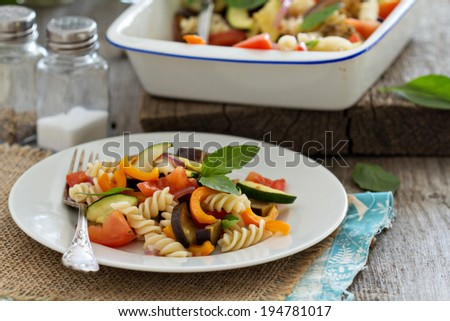 Baked ratatouille pasta with zucchini, eggplant and tomatoes - stock photo