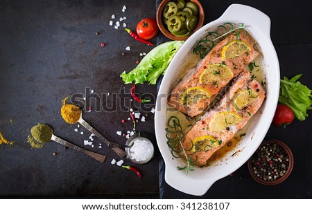 Baked salmon fillet with rosemary, lemon and honey. Top view - stock photo
