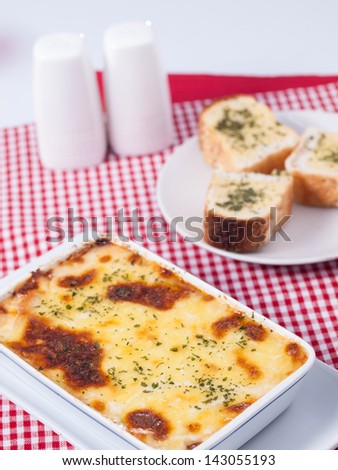baked spinach with cheese  and garlic bread - stock photo