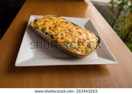 Baked spinach with cheese, spinach with cheese - stock photo