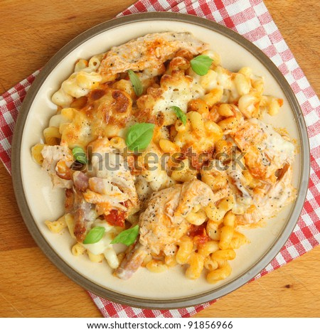 Baked spiral pasta with chicken, bacon and cheese. - stock photo
