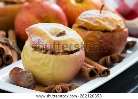baked stuffed apples on a plate, close-up, horizontal - stock photo