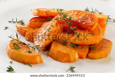 Baked sweet potato wedges on  white plate. Selective focus - stock photo