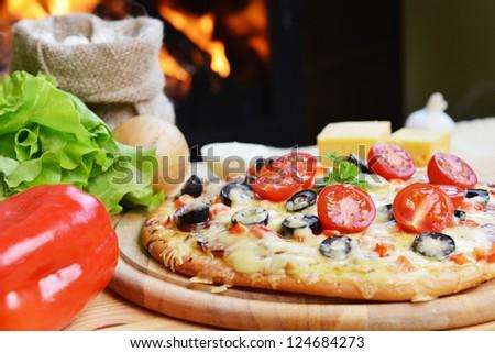 baked tasty pizza  near wood oven - stock photo