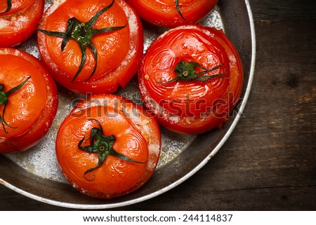 Baked tomatoes stuffed with vegetables and parmesan - stock photo