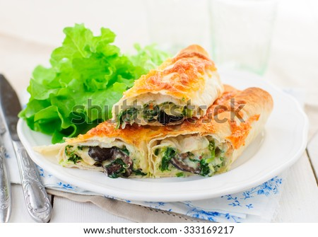 Baked Tortilla Rolls with Spinach, Chicken, Mushrooms and Cheese - stock photo