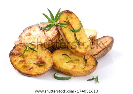 Baked unpeeled potatoes with rosemary - stock photo