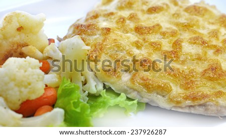 Baked veal cutlet with cauliflower and carrot garnish, restaurant and cafe main dish, close up - stock photo