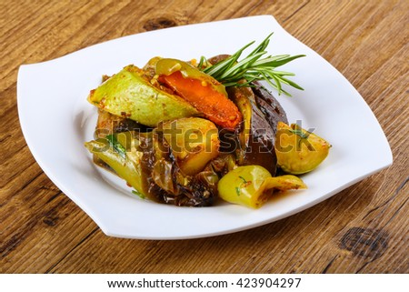 Baked vegetables - eggplant, pepper, tomato, carrot and zucchini - stock photo