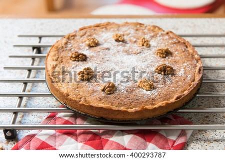 baked walnut cake in kitchen - stock photo