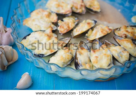 baked with cheese Dor Blue mussels - stock photo