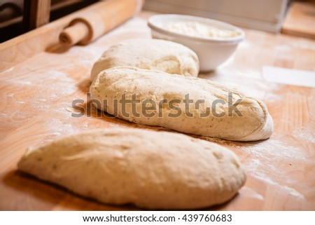 baker concept. Making dough by female hands on wooden table background. preparing in bakery - stock photo