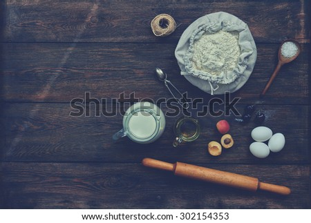 Baker trendy coffee shop, cooked products to bake one cake with fruits. On the table are the ingredients for the biscuit and pastry - stock photo