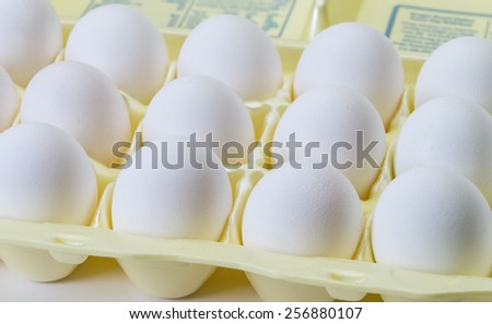 Bakers dozen of eggs for cook in kitchen - stock photo