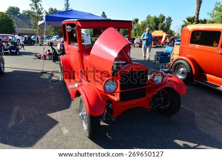 BAKERSFIELD, CA - APR 11, 2015: A red 1926 Ford Model T sedan is on display today at the Calvary Baptist Church Spring Car Show. This one is not stock, but quite a handsome custom version. - stock photo