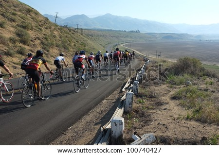 BAKERSFIELD, CA - APR 21: Men contestants ride the ninety mile mountainous route of the  Vlees Huis Professional  Road Race on April 21, 2012, in Bakersfield, California. - stock photo