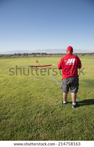 BAKERSFIELD, CA-AUGUST 24, 2014: An unidentified cintestant guides his sailplane to a precision points landing in the monthly contest hosted by the Southern San Joaquin Soaring Society. - stock photo