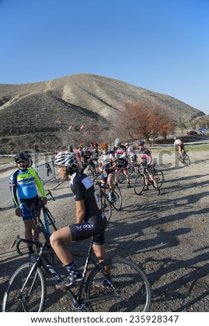 BAKERSFIELD, CA - DECEMBER 6, 2014: Contestants discuss the course of the Hart Park Cyclocross while waiting for the start. - stock photo