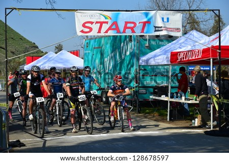 BAKERSFIELD, CA-FEB 17: Men contestants are ready for the start of the difficult Foothill Classic Cross Country Mountain Bike Race on February 17, 2013, in Bakersfield, California. - stock photo