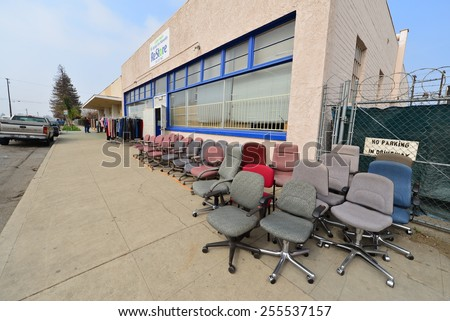 BAKERSFIELD, CA - FEBRUARY 20. 2015: The Habitat for Humanity's retail store moves merchandise outside in order to attract customers. - stock photo