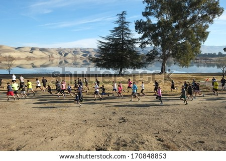 BAKERSFIELD, CA - JAN 11, 2014: The five kilometer race contestants are off to a fast start at the 24th Annual Fog Run, although there is good weather this year. - stock photo
