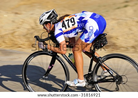 BAKERSFIELD, CA - JUNE 7: Solo woman rider has separated from the peloton, Golden Empire Classic professional bicycle road race championships, June 7, 2009, Bakersfield, CA - stock photo