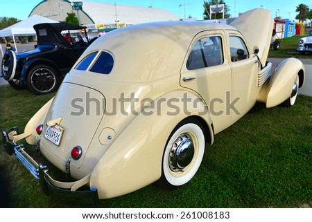 """BAKERSFIELD, CA - MARCH 14, 2015: The local car show is graced with this 1936 Cord Model 810 Westchester Sedan. The """"coffin nose"""" styling and concealed headlights are unique among classic automobiles. - stock photo"""