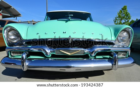 BAKERSFIELD, CA-MAY 17, 2014: The massive grill and hooded headlights of a 1958 Plymouth Savoy show the design features of that era at the South High School Car Show. - stock photo