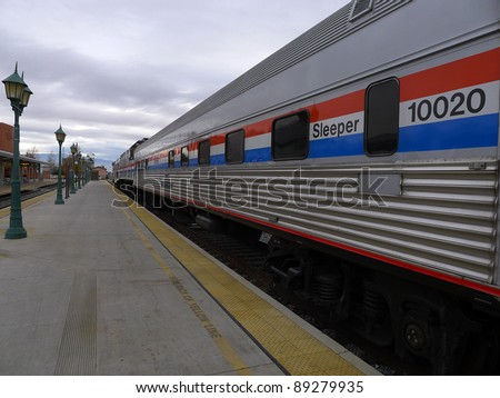 BAKERSFIELD, CA - NOV 20: Vintage 1950s era cars are part of Amtrak's 40th Anniversary Train visiting the station on November 20, 2011, at Bakersfield, California. - stock photo