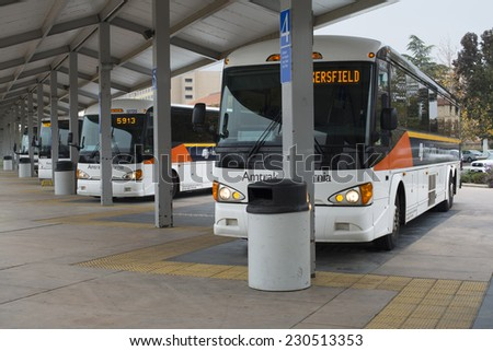 BAKERSFIELD, CA - NOVEMBER 14, 2014: Amtrak California makes extensive use of buses to connect rail passengers with places not accessible by the train. - stock photo