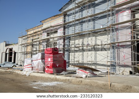 BAKERSFIELD, CA - NOVEMBER 22, 2014: As completion of the Shops at River Walk draws near, the exterior walls still have scaffolding in place for final finishing. - stock photo