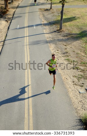 BAKERSFIELD, CA - NOVEMBER 7, 2015: Everyone starts together for the 33rd Annual Bakersfield Police Department Memorial Run but the faster runners soon move quickly to the front - stock photo