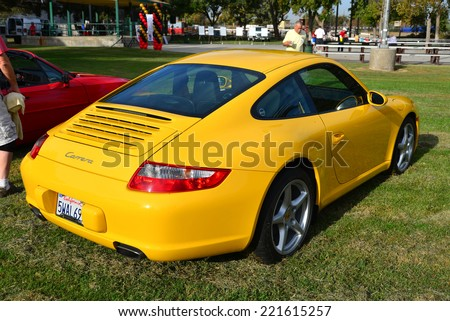 BAKERSFIELD, CA - OCTOBER 4, 2014: Dave Bratcher's yellow Porsche 911 Carrera is on display at the local Porsche club's  Concours D'Elegance.  - stock photo