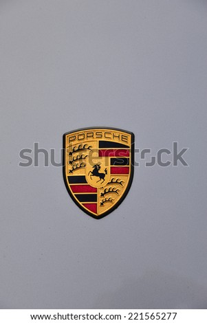 BAKERSFIELD, CA - OCTOBER 4, 2014: Mike McGregor has brought his model 911S Carrera to enter in the local Porsche club's Concours D'Elegance. The hood badge is one shared by all cars here today. - stock photo
