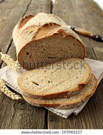 Bakery bread on old wooden boards - stock photo