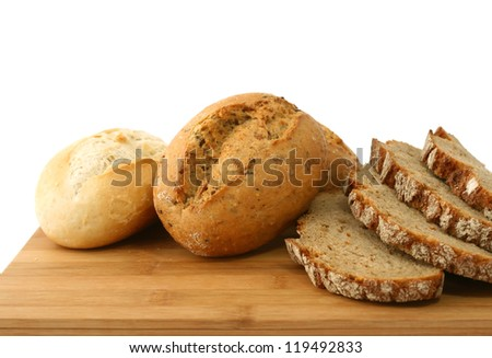 Bakery breads on wooden board on white - stock photo