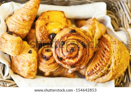 bakery items, pastries, croissants and scrolls - stock photo