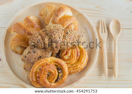 Bakery, Mini croissant sesame and Mini croissant ham on wood table for breakfast or tea time. - stock photo