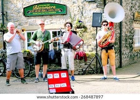 BAKEWELL, DERBYSHIRE, UK. APRIL 08, 2015.  A group busking on the street of Bakewell in Derbyshire, UK.. - stock photo