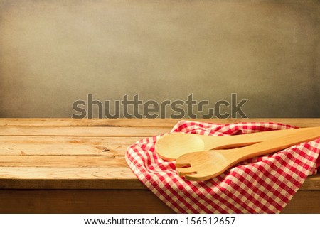 Baking and cooking background with wooden table and tablecloth - stock photo