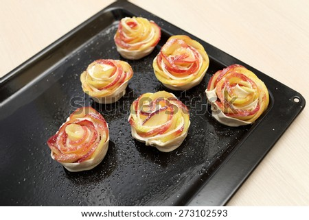 Baking apples in pastry on a tray - stock photo