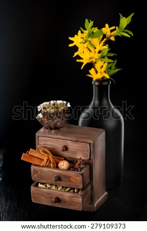 Baking background. Spices in wooden box - stock photo