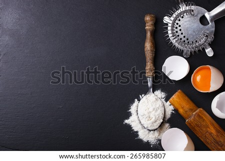 Baking background with eggshell,  flour and rolling pin .selective focus..Copy space. - stock photo