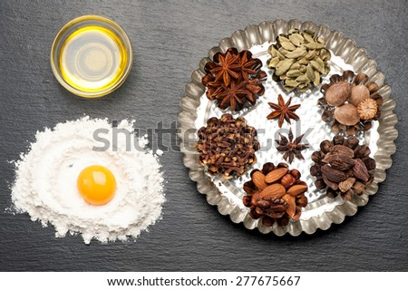 baking background with raw egg, flour, rolling pin, spicy and spices - stock photo