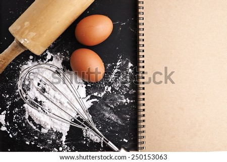 Baking cake ingredients. Bowl, flour, eggs,  on black chalkboard from above. Cooking course poster background  - stock photo