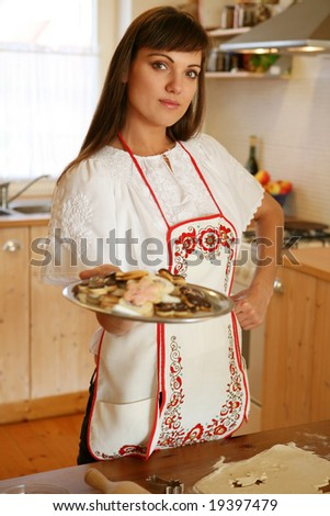 baking christmas cake,focus on woman face - stock photo
